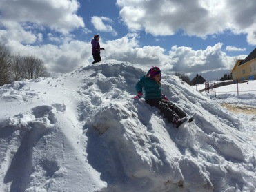Kids playin on the snow pile