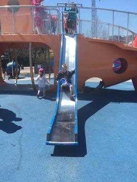 Noah going down the slide