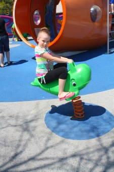 Ella riding the whale